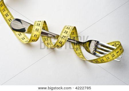 Diet Concept. Metallic Fork