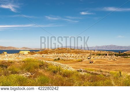 Landscape Of Delos Island In Greece - View From The Hill On The Island With Crystal Blue Sky And Big
