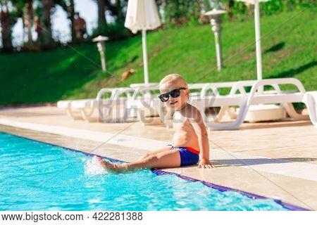 Happy Cute Baby Boy Having Fun At The Pool