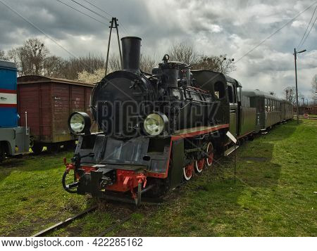 Queue On Narrow Tracks.  Rogow, Poland - April 25, 2021 A Unique Narrow-gauge Steam Locomotive With