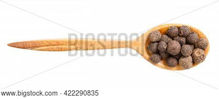 Top View Of Wood Spoon With Allspice Jamaica Peppers Isolated On White Background