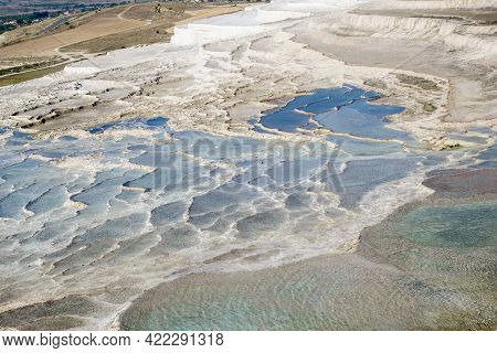 Panorama Of Travertine Terraces, Pamukkale, Turkey. Colors Of Water Very Different, From Light Blue
