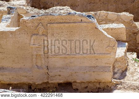 Side Part Of Antique Sarcophagus With Bas-relief Of God Or Human In Roman Clothes & Writing About Pe