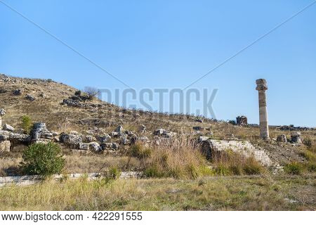 Lonely Standing Pillar Of Ruined Agora In Antique City Hierapolis, Pamukkale, Turkey. Also There Are
