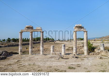 Remains Of Street Colonnade With Remains Of Pylons In Ancient City Hierapolis, Pamukkale. It's One O
