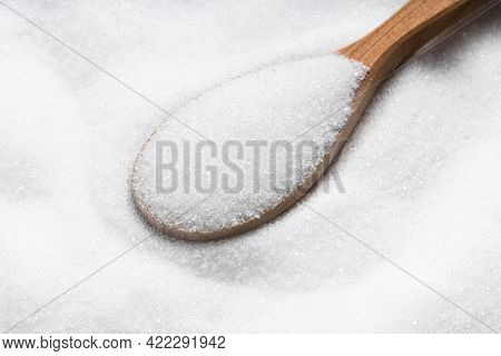 Above View Of Wooden Spoon With Sugar Substitute - Crystalline Extract Of Stevia Plant Close Up On P