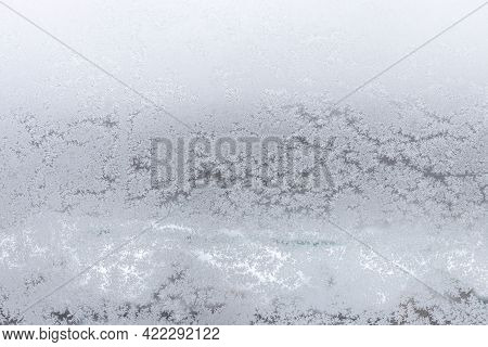 Frozen Window Glass In Urban Houses In City On Overcast Winter Day (focus On The Surface On Windowpa