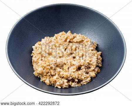 Porridge From Boiled Crushed Emmer Farro Hulled Wheat Groats In Round Bowl Isolated On White Backgro