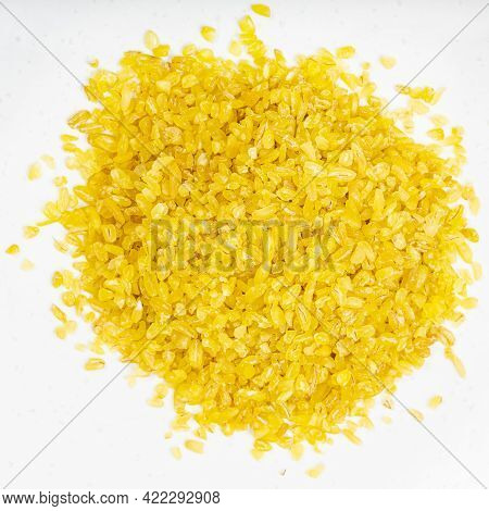 Top View Of Pile Of Bulgur Groats Close Up On Gray Ceramic Plate