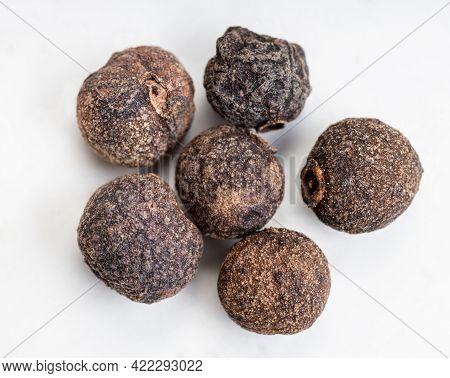 Few Allspice Jamaica Peppercorns Close Up On Gray Ceramic Plate