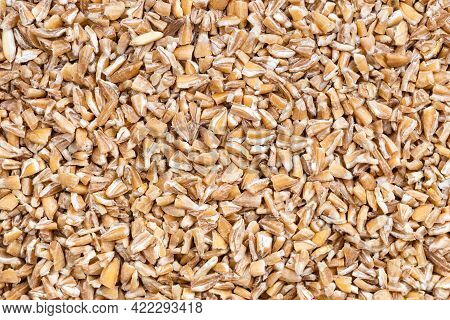 Food Background - Uncooked Crushed Emmer Farro Hulled Wheat Groats