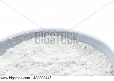 Top View Of Part Of Round Bowl With Wheat Flour Isolated On White Background