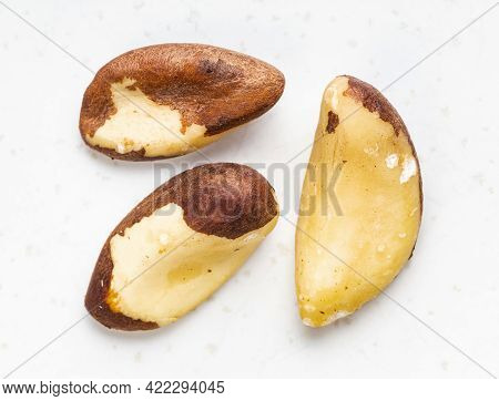 Several Raw Brazil Nuts Close Up On Gray Ceramic Plate