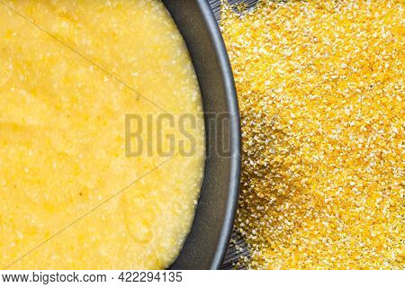 Top View Of Cooked Maize Porridge In Gray Bowl And Cornmeal Gray Wooden Table