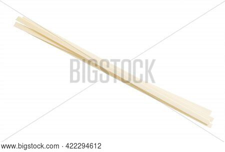 Few Dried Flat Udon Noodles From Wheat Flour Isolated On White Background
