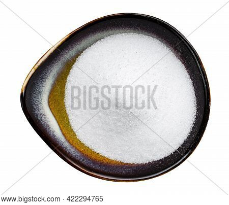 Top View Of Crystalline Erythritol Sugar Substitute In Ceramic Bowl Isolated On White Background