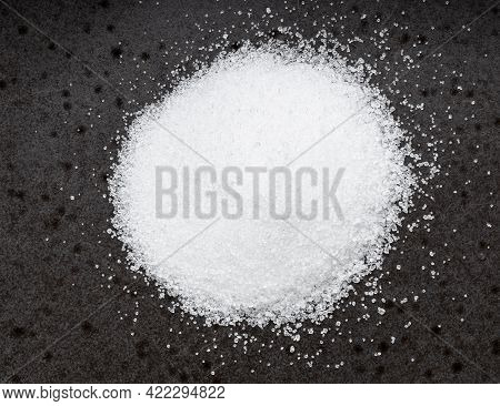 Top View Of Pile Of Sugar Substitute - Crystalline Extract Of Stevia Plant Close Up On Black Ceramic