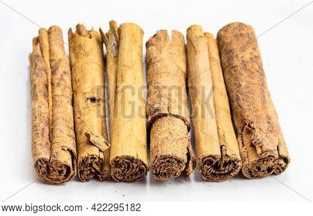 Several Sticks Of Continental Ceylon Cinnamon Close Up On Gray Ceramic Plate