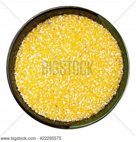 Top View Of Coarse Cornmeal In Round Bowl Isolated On White Background
