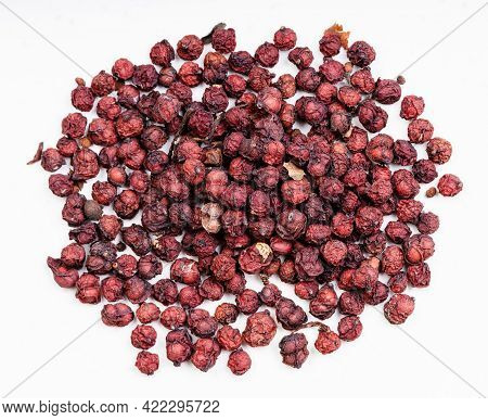Top View Of Pile Of Dried Magnolia Berries (schisandra Chinensis Fruits) Close Up On Gray Ceramic Pl