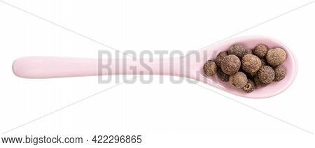 Top View Of Ceramic Spoon With Allspice Jamaica Peppers Isolated On White Background