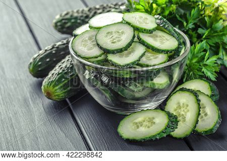Cucumber On  Dark Wood Texture Background.cucumbers Harvest In Summer. Cucumbers For Salads Or Canni