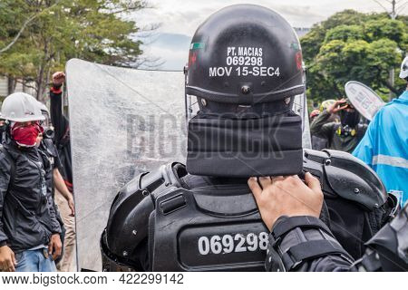 MedellÍn, Colombia - May 28, 2021: Anti Riot Police Behind His Shield Seen From The Back. His Partne