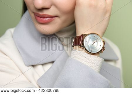 Woman With Luxury Wristwatch On Green Background, Closeup