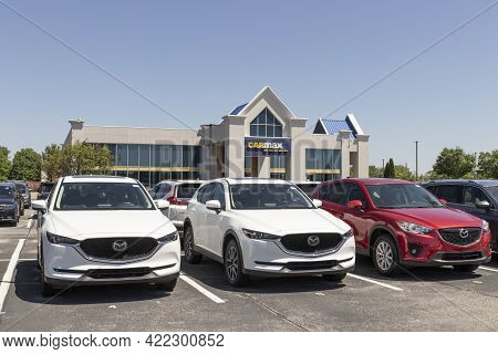 Indianapolis - Circa May 2021: Carmax Auto Dealership Mazda Display. Carmax Is The Largest Used And