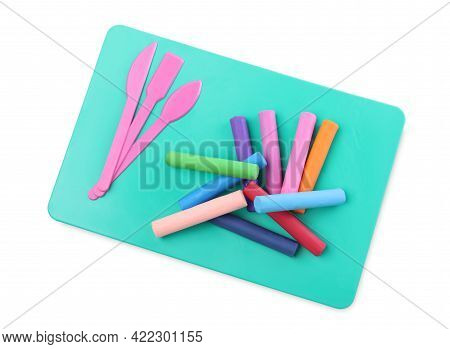 Many Different Colorful Plasticine Pieces And Sculpting Tools On White Background, Top View