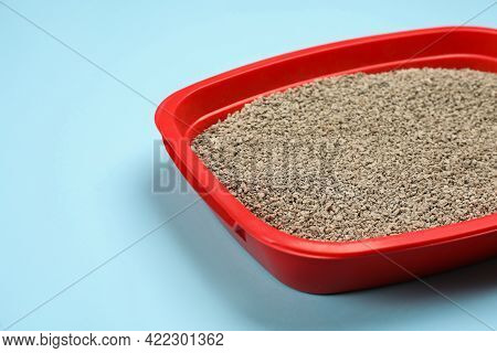 Cat Litter Tray With Filler On Light Blue Background, Closeup
