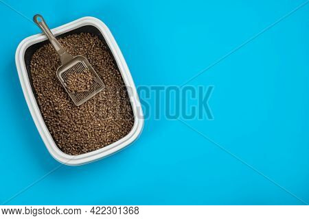 Cat Litter Tray With Filler And Scoop On Light Blue Background, Top View. Space For Text