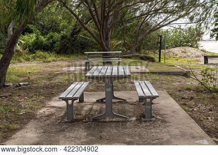 Mackay, Queensland, Australia - May 2021: Picnic Table And Chairs Under Trees On The Beachfront, Cas