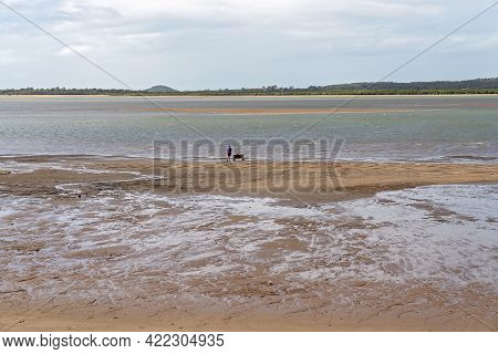 Mackay, Queensland, Australia - May 2021: Fisherman With A Trolley To Carry The Gear, Standing Besid