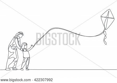 One Continuous Line Drawing Of Young Arabian Dan Nad Daughter Flying Kite Together At Outdoor Field.
