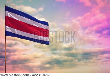 Fluttering Costa Rica Flag Mockup With The Place For Your Text On Colorful Cloudy Sky Background.