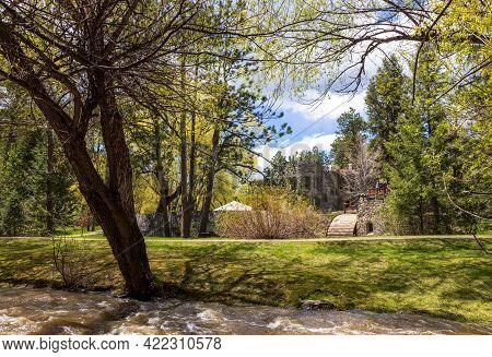 Scenic Spring Landscape In Lair O\' The Bear Park With The View Of Dunafon Castle Near The Town Of M