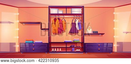Spacious Walk-in Closet Or Dressing Room Full Of Male And Female Clothes. Dresses Hang On Hangers, B