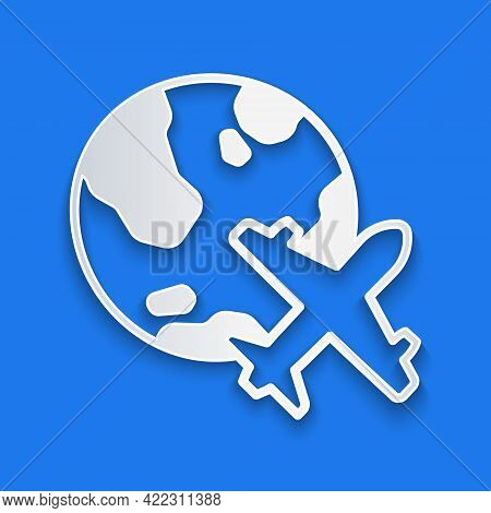 Paper Cut Globe With Flying Plane Icon Isolated On Blue Background. Airplane Fly Around The Planet E
