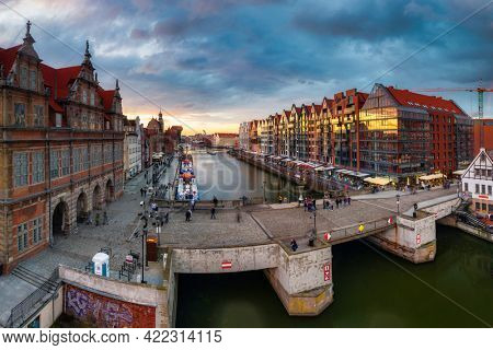 Gdansk, Poland - May 23, 2021: Amazing architecture of the main city in Gdansk at sunset, Poland. Aerial view of the Motlawa river and granaries island.