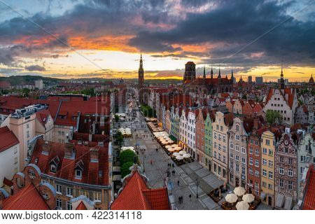 Gdansk, Poland - May 23, 2021: Amazing architecture of the main city in Gdansk at sunset, Poland. Aerial view of the Long Market, Main Town Hall and St. Mary Basilica