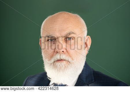 Closeup Face Of Professor Or Teacher On Blackboard Isolated. Senior Professor With Gray Hair In Coll