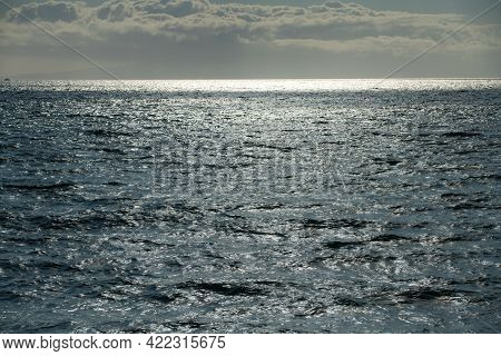 Abstract Sea Nature Background. Water Waves In Sunlight With Copy Space. Tropical Beach. Watering Pl