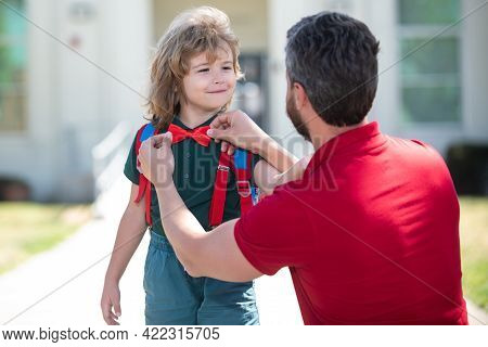 Father Helping Son. Little Boy Going To School. Schoolboy Is Ready Go To School. Family Education An