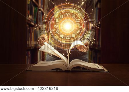 Woman Reading A Astrology Book. Astrological Wheel Projection, Choose A Zodiac Sign. Trust Horoscope
