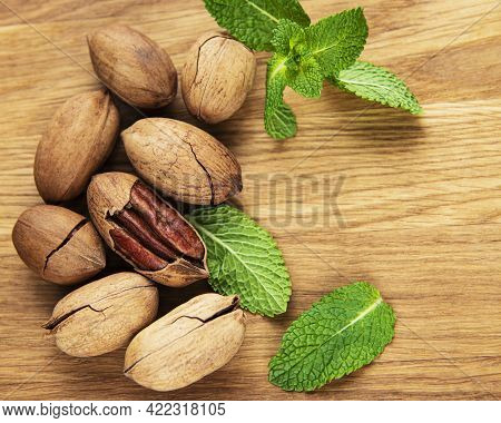 Pecan Nuts On A Old Wooden Table
