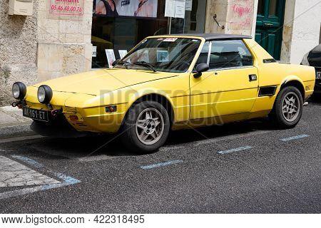 Bordeaux , Aquitaine France - 05 27 2021 : Fiat X1/9 Bertone Yellow Vintage Sports Car Oldtimer Clas