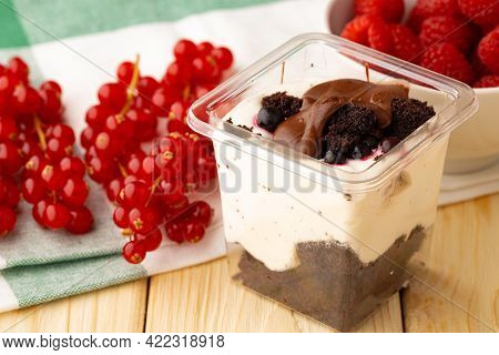 Mousse Dessert With Chocolate On Wooden Background