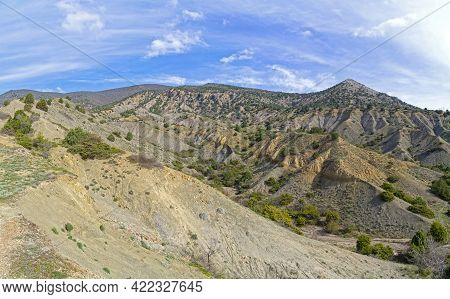 Clay Ravines At The Foot Of The Mountains. On The Slopes Of Ravines One Can See The  Structure Of Se
