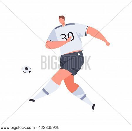 Football Player Running And Kicking Ball With Foot. Professional Athlete In Uniform And Boots Playin